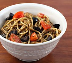 Spaghetti with basil pesto, tomato and olives: a no-cook sauce that makes an easy worknight dinner.