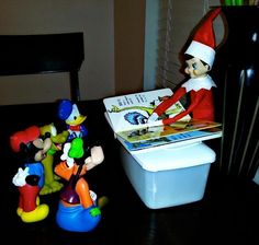 Elf on the Shelf (reading to his farmer men and animals)....