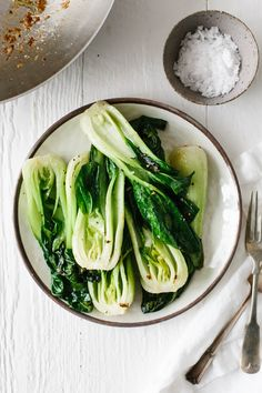 Bok choy cooked with garlic and ginger in a quick stir-fry recipe. It's nutritious, tasty and packed with health benefits. Use baby bok choy or regular sized bok choy. Healthy Side Dishes, Vegetable Side Dishes, Side Dish Recipes, Vegetable Recipes, Asian Recipes, Healthy Foods, Healthy Recipes, Whole30 Dinner Recipes, Vegetarian Recipes