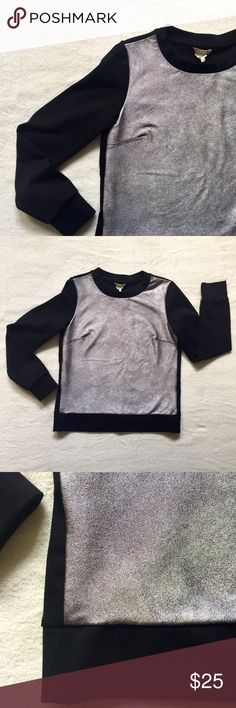 Club Monaco Metallic Silver Sweatshirt Adorable jumper from Club Monaco.  New condition.  Shimmery silver front, jet black sleeves and back.  High quality, excellent construction.  The fabric is extremely comfortable, but doesn't have a ton of give like a traditional sweatshirt.  Because of this, I would say it is more of an XS/S.  Open to all offers - next-day shipping ✨✨ Club Monaco Tops Sweatshirts & Hoodies