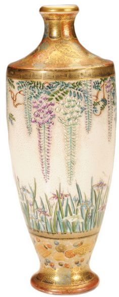 A Satsuma pottery bottle form vase, Japanese, circa 1875-1900, bodly elaborately decorated with wisteria and irises, banded top and bottom with repeating gilt stylized flower heads and fans
