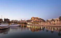 Alicante harbour with boats, seaside walk and the castle at sunset #trivo