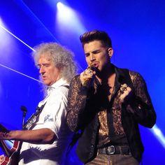 Adam Lambert performing with Queen's Brian May...2014