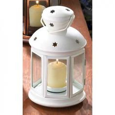 White Colonial Candle Lantern.  A traditional candle lantern gets a fresh contemporary look with matte white finish and charming star cutouts! A simple yet elegant complement sheds festive light on any setting. #colonial #white #lantern #decor