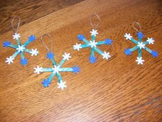 Glue popscicle sticks together in shape of a snowflake. Paint light blue ( we had glitter paint). When dry, glue on foam snowflakes and a hanger.
