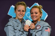 Abigail Johnston and Kelci Bryant of the United States pose with their silver medal for Women's Synchronised 3m Springboard