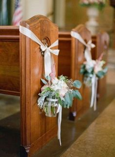 Jam jars with posies for the pew ends this is a possibility once stunning wedding aisle decor arrangment hanging from church pew happywedd junglespirit Choice Image