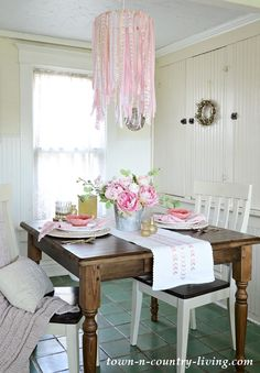 When summer rolls around I like to add a bit of decorating whimsy. To create a pretty summer table setting, I decided to make an easy DIY ribbon chandelier in pink and white. I'm sharing the instructions so you can make one of your own! Fresh Farmhouse, Country Farmhouse Decor, Rustic Decor, Country Living, Farmhouse Style, Cottage Style, Vintage Decor, Ribbon Chandelier, Outdoor Chandelier