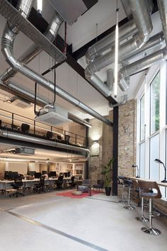 Notting Hill based studio DHLiberty  recently completed a warehouse  conversion space including the offices for Analog Folk, in Shoreditch East  London. Lets take a look.  The brief was to harness the company's use of traditional values and  digital technology to inform the look and feel of the space.