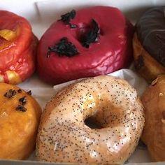 Dough bakery in Brooklyn - box of doughnuts:  blood orange, hibiscus, chocolate glazed, passion fruit, lemon poppy, dulce de leche | Yelp