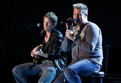 Joe Don Rooney (left) and Gary LeVox of Rascal Flatts rehearse onstage for the 44th annual ACM Awards in Las Vegas on April 3, 2009.