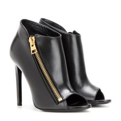 Tom Ford - Open-toe leather ankle boots - Tom Ford's peep-toe ankle boots upgrade the classic silhouette. Exquisitely detailed with a slanted gold-tone zip fastening and a sky-high heel, this leather pair will lend a razor-sharp edge to any evening look. seen @ www.mytheresa.com