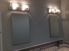 The lights above the two beveled mirror medicine cabinets (mirrored inside too) are modern and elegant.  There isn't a blast of light from them but I have overhead pot lights that provide the right light for makeup and shaving.  These work better for ambiance and spotlight to the area.  The color on the walls was recommended by Cambria to match the vanity top. Spa like and reminding me of the beach.