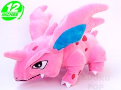 Pokemon Nidorino Plush Give Nidorino a new home today! These toys feature fantastic detailing including the spines and horn, along with those rather cute little fangs. - Plush is approx 30 cm / 12 inches tall. - Brand new with tags. - Ages 6 & up.