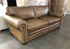 "Check out this Langston Leather Sofa with custom options recently delivered to Newport News, NY! 4"" were added to our 84"" Langston Sofa for a custom length of 88"" and 19mm French Natural Nail Heads were also added, placed according to customer preference. The Italian Berkshire Burlap, a Full Grain, Full Aniline, Oiled Pull-up leather will break in nicely with our Feather & Down Seats and Back Cushions and we know this customer will be enjoying this piece for some time to come! Build your La"
