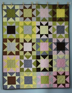 lovely quilt with solids for a twin (click on the link to see the matching churn dash quilt)