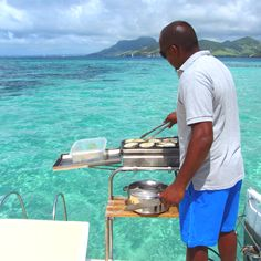 One day on the catamaran, grilling on board, east coast, Mauritius