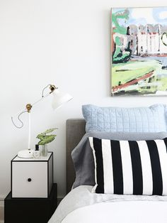 The Sydney home of Dominique & Ashley, shot by Eve Wilson for The Design Files. Bedlinen is from Bemboka & Sheridan, bedside table – 'By Lassen' Frame boxes from Fred International, painting by Paul Connor, lamps by Ikea.