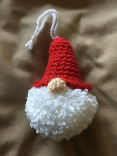 Crochet Patterns Ravelry: Puffball Gnome Ornament pattern by Alexandra Halsey Gnome Ornaments, Crochet Ornaments, Crochet Crafts, Yarn Crafts, Free Crochet, Crochet Food, Crochet Christmas Decorations, Christmas Crochet Patterns, Diy Christmas Ornaments