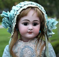 Offered is a beautiful brown eyed 20 German bisque DEP Bebe with closed mouth wearing a luscious blue French-style costume.  Her bisque socket head is