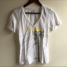"""White v-neck tshirt with bird design White v-neck tshirt with birds sitting on a wire. Words stating """"Waste Not"""" in yellow. Cute! Never worn, NWOT: Old Navy Tops"""