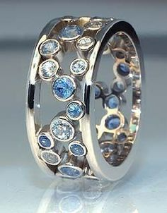 Janet's ring | Eva Martin Jewelry. Those crystals look like little blue bubbles...pinned by ♥ http://wootandhammy.com, thoughtful jewelry.
