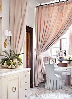 Heavy bathroom window curtains in pale pink separate this feminine space into distinct zones. Attached with rings, one curtain creates a vanity niche when closed. Another curtain partitions dry spaces from the tub and shower. Bathroom Window Curtains, Bathroom Window Treatments, Bathroom Windows, Curtain Partition, Curtain Panels, Ideas Armario, Amazing Bathrooms, Modern Bathrooms, Malm