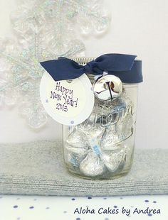 It Maybe Too Late To Do This, This Year, But It Will Be Awesome To Do For The Next...New Years Eve Party Favor...Mason Jars Filled With Candy Kisses...Wrap With A Navy Blue Ribbon & Attach A Silver Bell, Then Personalized With A Gift Tag...