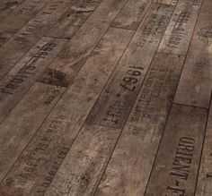 wood flooring made of pallets.  I love the stamping...it looks so rustic! by 9lee