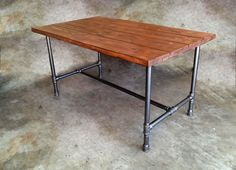 I would love this, except in silver colored galvanized pipe and an ash stained wood top.