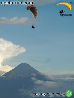 Paragliding flight Baños Ecuador Fly over the mountains doing paragliding, a sport and adventure tourism. Feel adrenaline and excitement