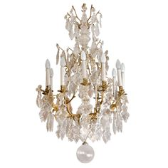 A Fine Louis XV Bronze And Cristal 12 Lights Chandelier 19th Century   From a unique collection of antique and modern chandeliers and pendants  at https://www.1stdibs.com/furniture/lighting/chandeliers-pendant-lights/