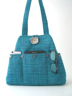 This handmade handbag ,shoulder bag ,can be worn as hobo shape or as tote bag . you can use it as diaper bag, laptop bag , great everyday bag . day to evening bag ,made in USA view more handbags by daphne bags @ http://www.etsy.com/shop/daphnenen You can change the shape of the bag in seconds by simply tying or untying the metal lobster hook. (See picture)  the bag Made from a HIGH QUALITY ITALIAN Turquoise -blue upholstery fabric -Handmade to be extremely strong and durab...