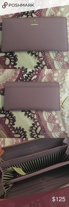 Kate Spade Zip Around Wallet Purple zip around Kate Spade wallet. In great condition! Has slots for cards and coin areas as well. Large and a great wallet! kate spade Bags Wallets