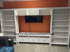 ikea HEMNES TV storage combination assembled for company reception lounge in gwynn oak MD by Furniture Assembly Experts LLC