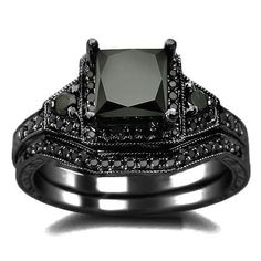 Black Princess Cut Diamond Engagement Ring Wedding Set - This unique certified 2.01ct Black Princess Cut Diamond Engagement Ring Wedding Set are stamped in 14k Black Gold. An excellent AAA quality 1.46 carat solitaire princess cut black diamond is set atop the ring. .55 carats of round diamonds surround the solitaire. They are lovely sparkling stones set on the the ring & matching band in a prong & pave setting. The ring's top measures 9.4mm wide at its largest point. #unusualengagementrings