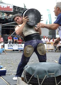 Stone lifter Josetxo Urrutia lifts a stone during a rural Basque sports championship during the San Fermin Festival in the Northern Spanish city of Pamplona.