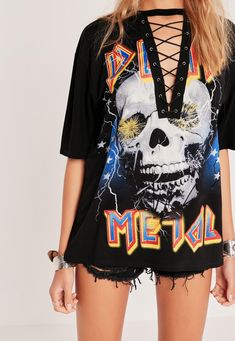 """Channel your inner badass and give off major metal head vibes in this lace up top. the perfect little piece for throw on and go style this festival season, wear with ripped skinny jeans and ankle boots for a look that screams """"I'm with the ..."""