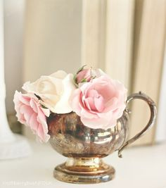 Pink roses in a silver tea pot.. love tea pot needs more flowers