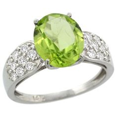 14k White Gold Peridot Engagement Ring - This Beautiful Peridot Engagement Ring is crafted from Solid 14 Karat Gold & set with Genuine Diamonds & a Precious Gem. This ring is stamped in White gold with a minimum total gem weight of 2.65 carats. It has a lovely color quality of H-I with a pristine diamond clarity of SI1-SI2. These diamond have been heat treated & they're all 100% natural stones. #unusualengagementrings