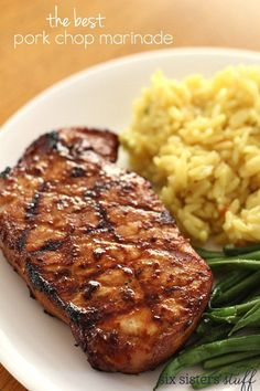 The BEST Pork Chop Marinade on SixSistersStuff.com - it's so easy and so delicious! Marinated only 40 minutes or so, was still great!
