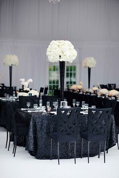 Tall, black & white centerpieces topped sequined linens. Black and white wedding, black tie wedding ideas, new year's eve wedding