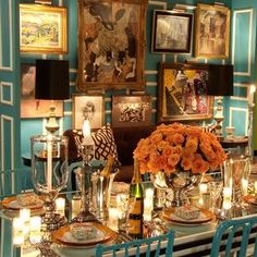 Where to start! Tiffany blue walls with white picture molding, My favorite: orange roses, the amazing picture display and the lavish table setting. Love!