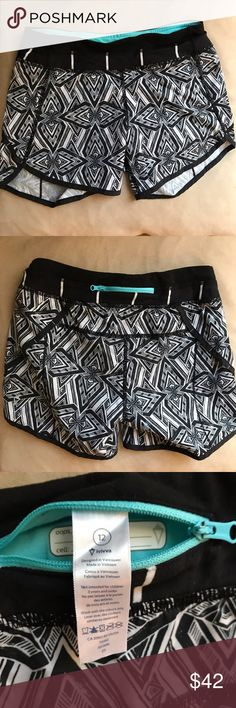 Lululemon Ivivva Geometric Speedy Running Shorts This is a super cute pair of Ivivva by Lululemon Speedy Running Shorts. Size 12 kids. Black and white geometric design. No flaws. Worn 2 times. Ivivva Bottoms Shorts