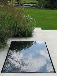 Simple dark pond with pale stone and grasses - (garden detailing, outdoors, water feature, backyard) Pool Water Features, Water Features In The Garden, Modern Landscaping, Pool Landscaping, Pool Pavers, Garden Pool, Water Garden, Pool Backyard, Backyard Ideas