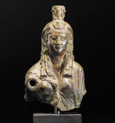 AN EGYPTIAN BRONZE BUST OF ISIS OR A PTOLEMAIC QUEEN - 1ST CENTURY B.C.