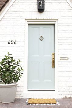 dream door + white brick door A Fixer-Upper Gets A Modern Renovation Door Paint Colors, Front Door Colors, Exterior Paint Colors, Paint Colors For Home, House Colors, Exterior Design, Front Doors, Front Porch, Front Door Numbers