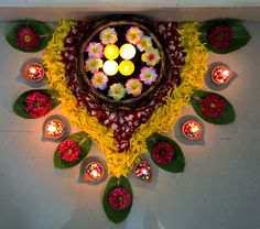 Diyas arranged in thermocol balls n also with flowers..