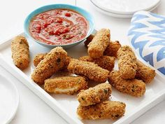 Baked-not-fried Crisp Mozzarella Sticks are a fun crispy, oozy appetizer for the whole family--and one that has calcium goodness. The pizza flavor profile makes them extra tasty for kids' palates.