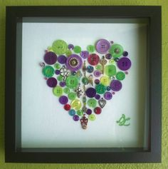 The first heart made out of hand sewn buttons and charms I made for an other friend of mine Stephanie If fits perfectly on her office wall!!! Sneaked in before I made the heart of course...:-)
